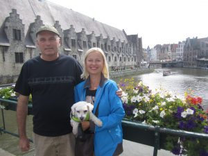 two people and a puppy in front of the canal in Ghent Belgium