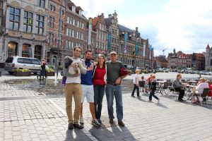 a happy group in front of the unique architecture of Tournai