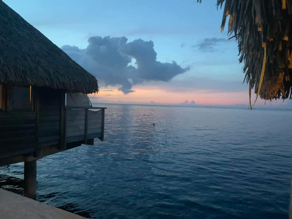 sunrise off the deck of an over water bungalow in Moorea