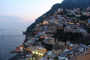 the cliff side town of Positano lit up at night