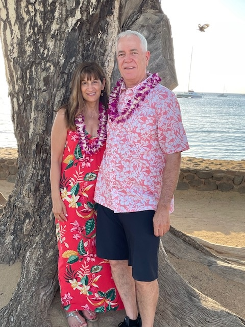 a happy couple on their anniversary trip in Hawaii